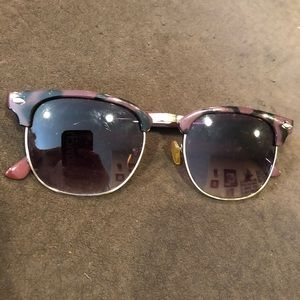 purple tortoise rim sun glasses